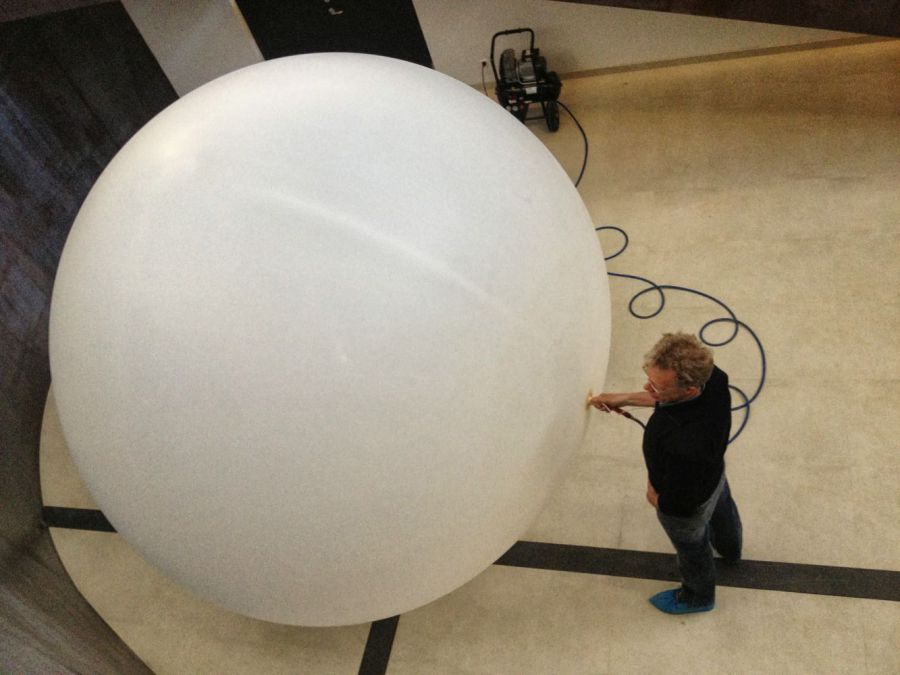 A balloon test to decide the size of the apple. It took 3 hours to fill the balloon